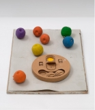 Untitled, 2016, Chipboard, clay, rubber balls, wooden dog toy, acrylic, 5 x 46 x 61 cm